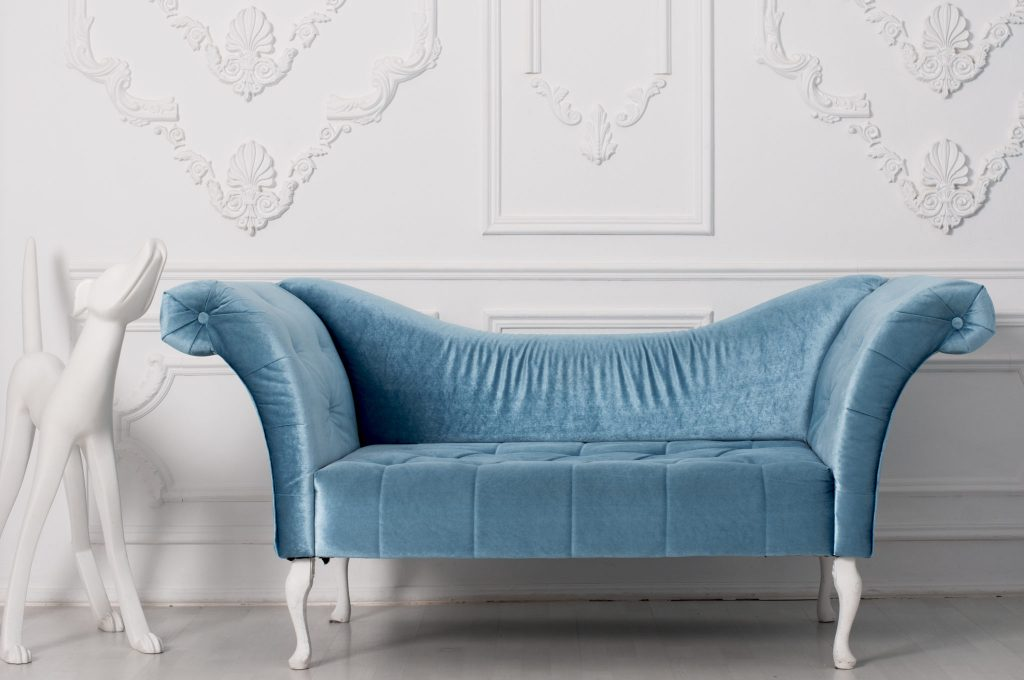 A blue velvet couch