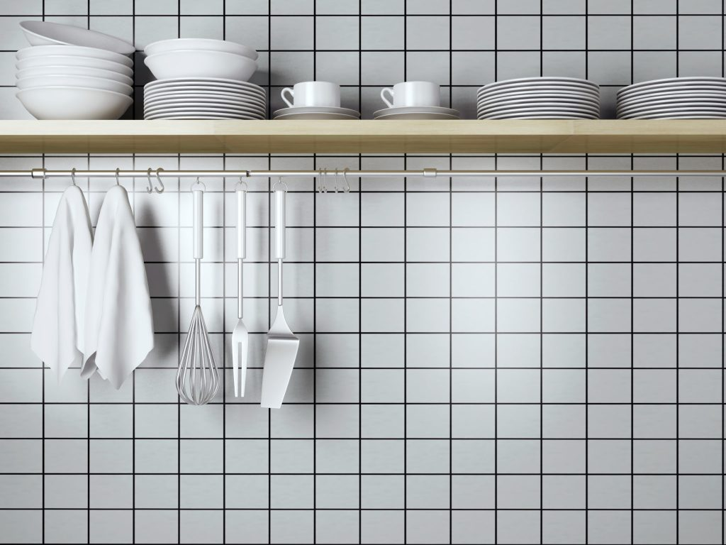 A wall of white tile in a kitchen