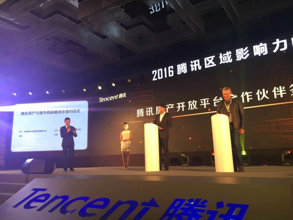 Tencent and Juwai announcing the partnership in Beijing.